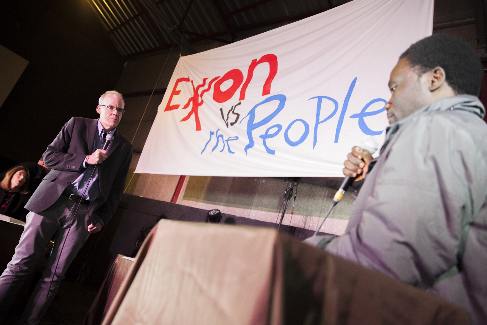 Exxon versus the People Bill McKibben Niger delta activist Ken Henshaw in Paris- Mychaylo Prysupa