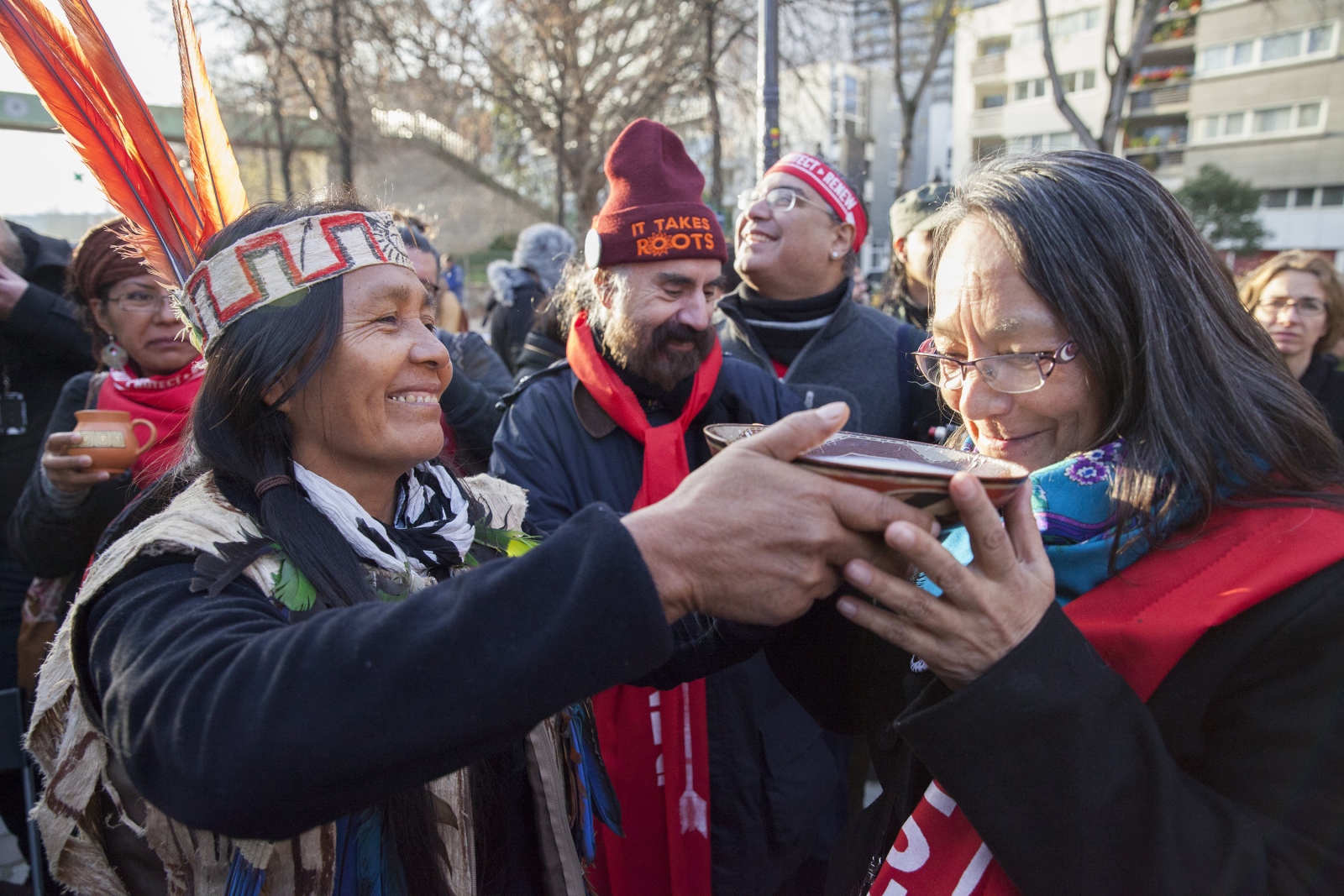actress_tantoo_cardinal_gets_drink_from_equador_woman_paris_indigenous_rally_climate_talks_cop21_-_mychaylo_prystupa