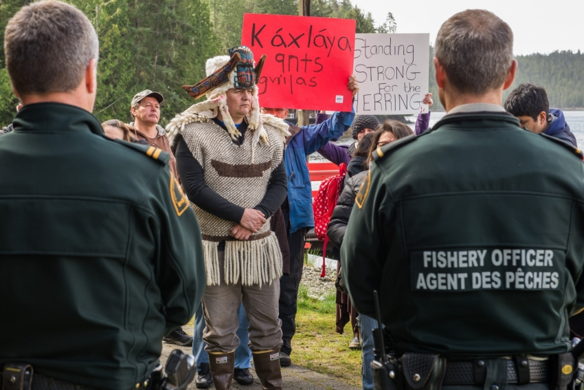 Frank Brown faces off against DFO officers in a Heiltsuk protest