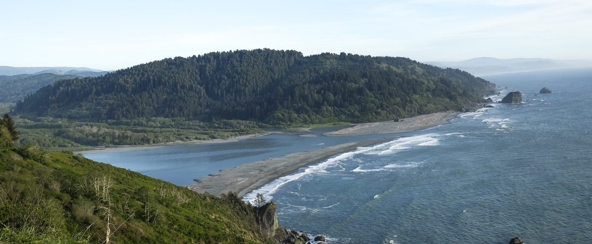 The Klamath River where it meets the Pacific Ocean. Photo from Tami Heilemann, DOI