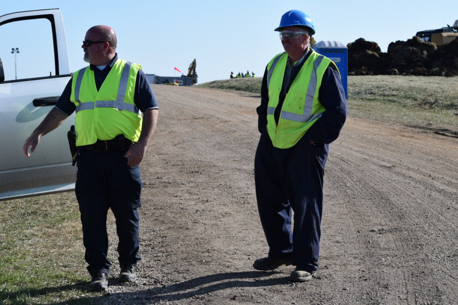 Armed guards stand near TransCanada Keystone spill site