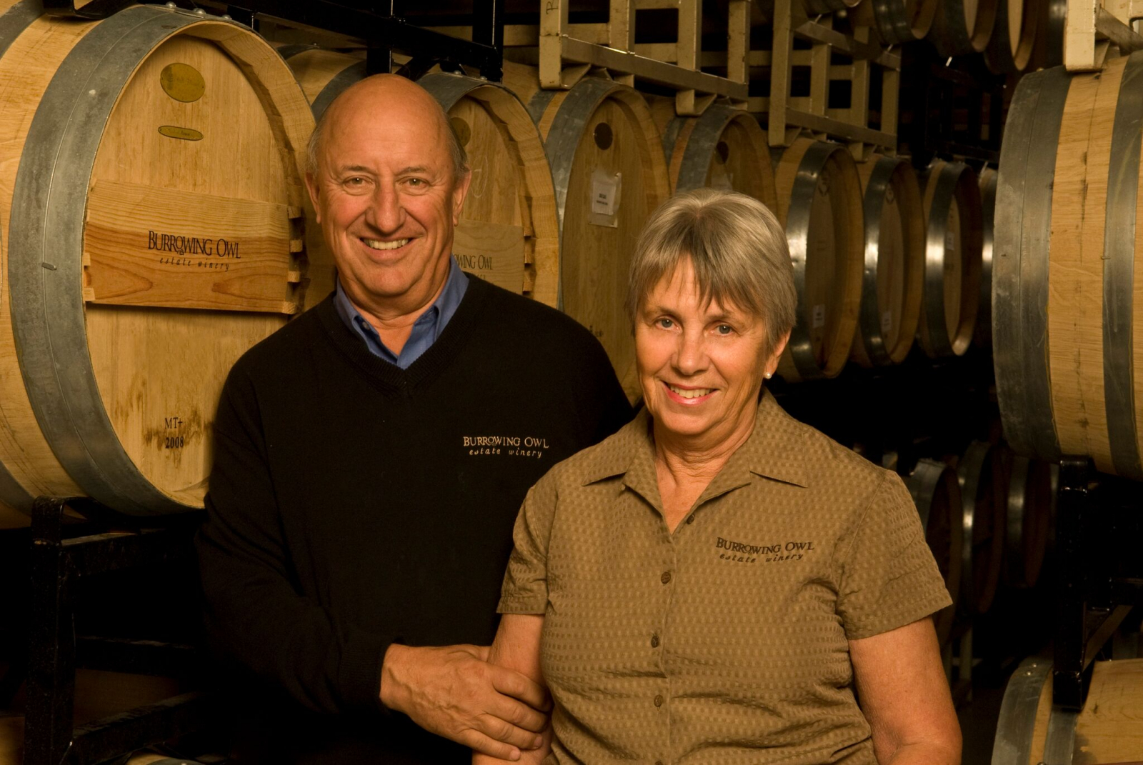 Jim and Midge Wyse in Burrowing Owl's wine cellar. Photo by Burrowing Owl Winery