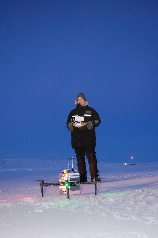 A researcher getting ready to send a drone up in the Arctic. Photo by Dalhousie University