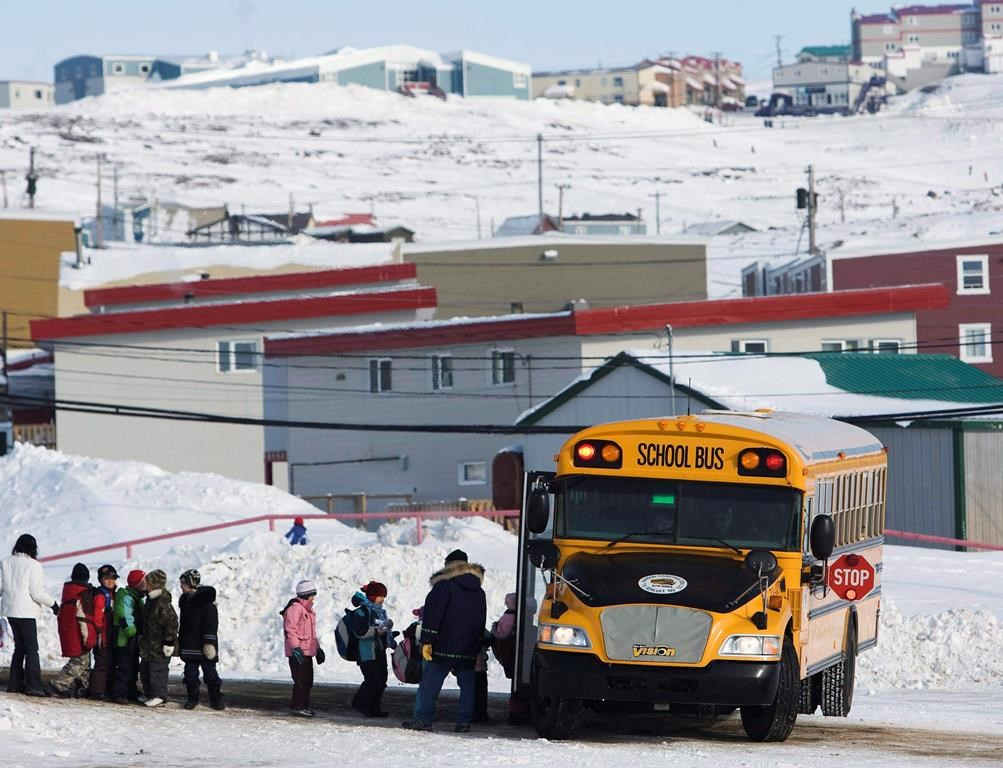 Students board a school bus at the Nakasuk Elementary School in Iqaluit, Nunavut, in a March 30, 2009, file photo.