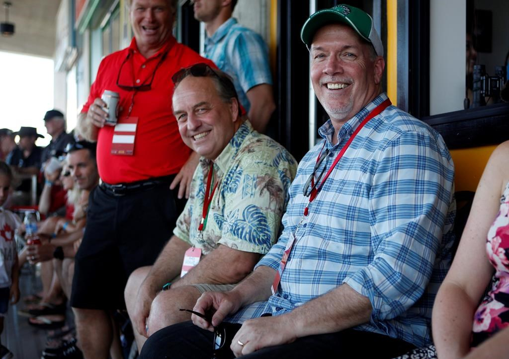 B.C. Green party leader Andrew Weaver and B.C. NDP leader John Horgan take in the final match between Team Canada and New Zealand during cup final action at the HSBC Canada Women's Sevens at Westhills Stadium in Langford, B.C., on May 28, 2017.