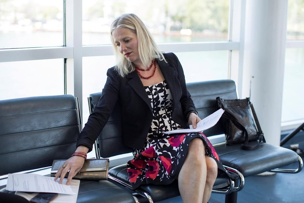 Environment Minister Catherine McKenna reads her notes before delivering a policy announcement in Toronto on Wednesday May 31 , 2017.