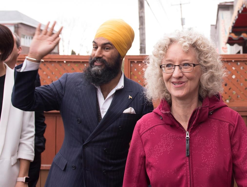 NDP Leader Jagmeet Singh, left, waves as he arrives for a news conference during a campaign visit for local candidate Gisele Dallaire, right, Tuesday, October 10, 2017 in Alma Quebec. THE CANADIAN PRESS/Jacques Boissinot