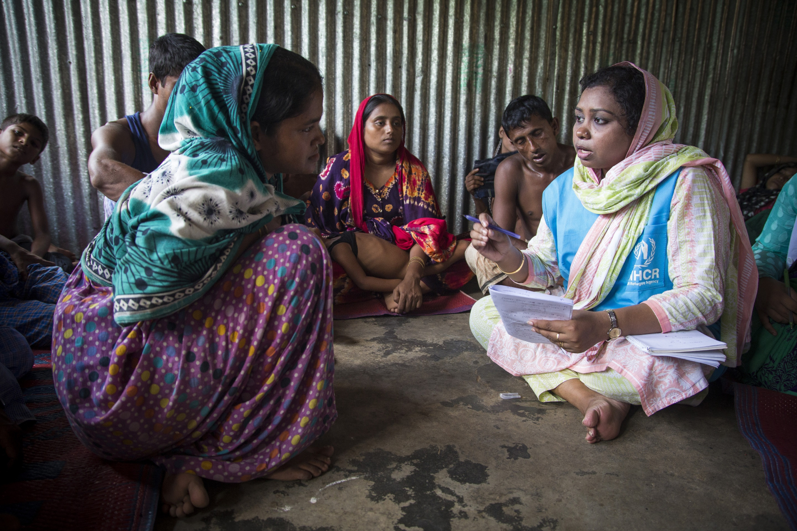 Rashida Begum, 23, a Rohingya shipwreck survivor who lost relatives when her boat capsized on Inani Beach near Cox's Bazar, receives counselling from UNHCR psychologist Mahmuda at Kutupalong refugee camp in Bangladesh. Photographer Roger Arnold
