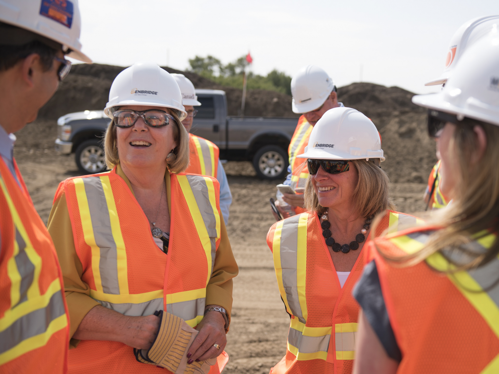 Alberta Energy Minister Margaret McCuaig-Boyd (left) and Premier Rachel Notley tour Enbridge's Line 3 pipeline replacement site at Hardisty, Alta. on Aug. 10, 2017.