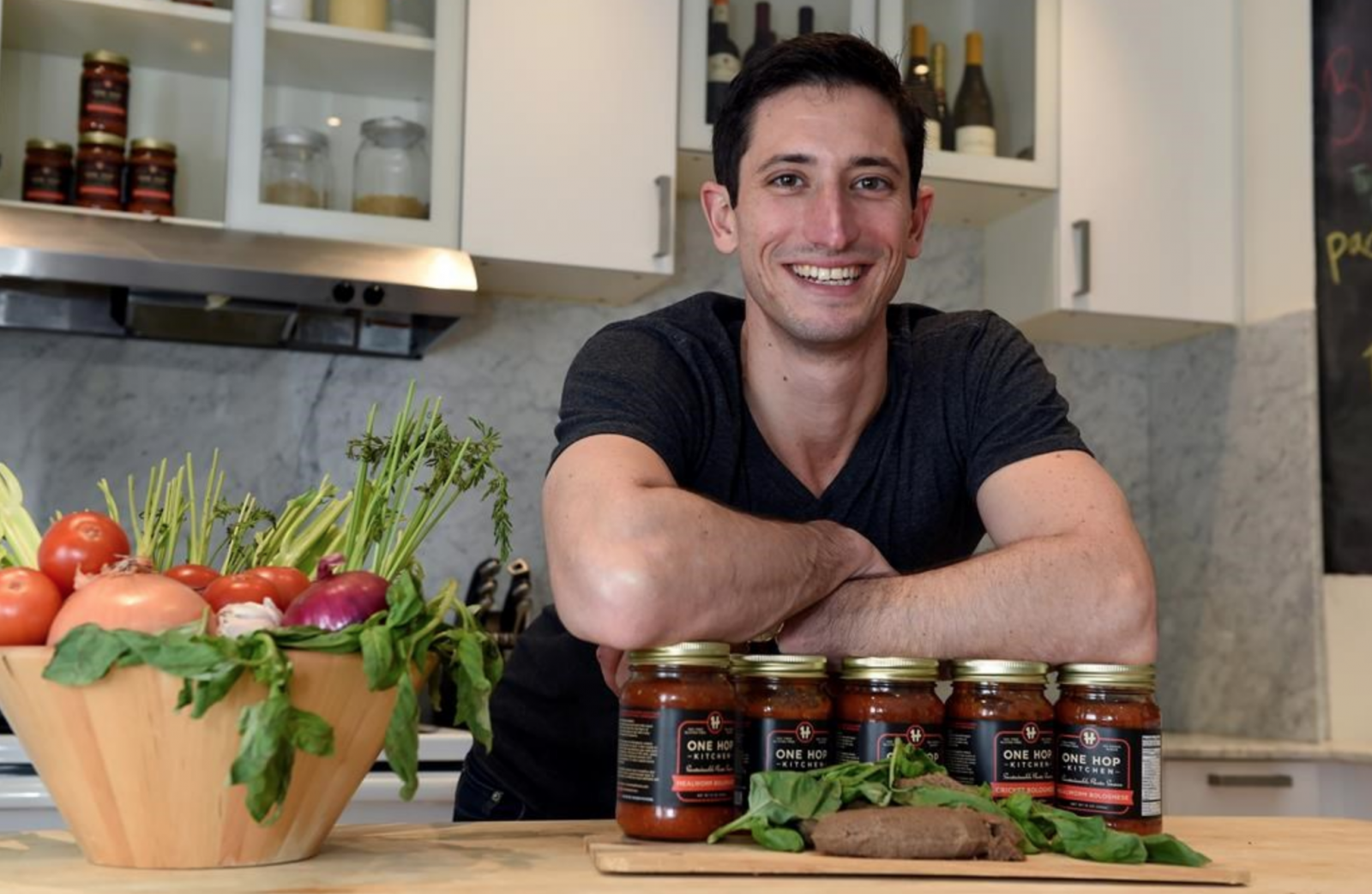 Eli Cadesky, CEO of C-fu Foods in Toronto, shows off his jars insect-based pasta sauce. File photo by Canadian Press