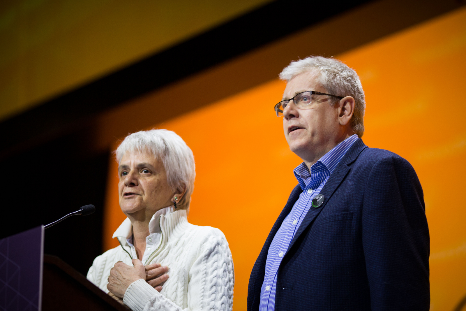 NDP MPs Charlie Angus and Helene Laverdiere speak to NDP delegates about Paul Dewar's brain cancer diagnosis in Ottawa on Feb. 17, 2018. Photo by Alex Tétreault