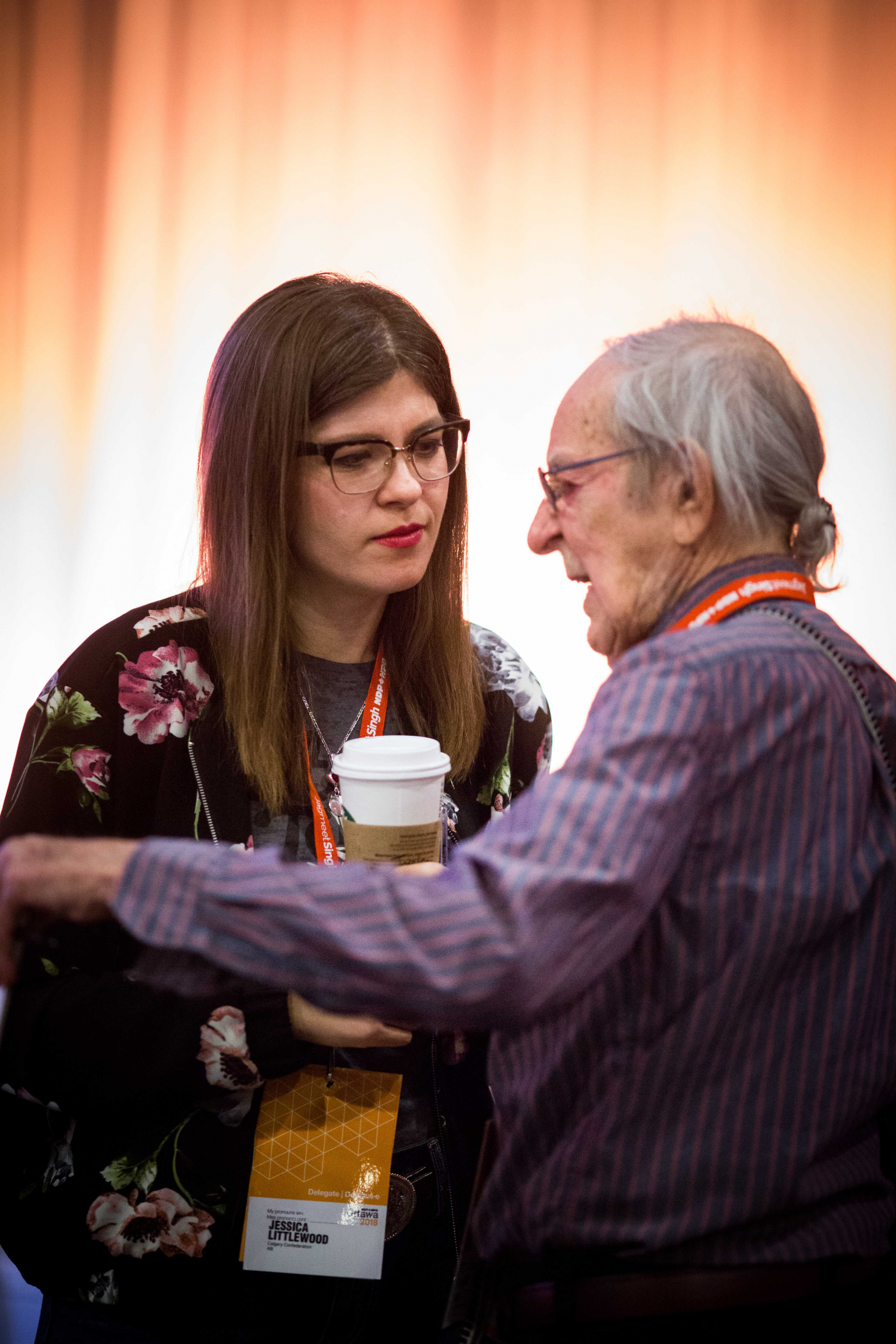 Alberta MLA Jessica Littlewood talks to a fellow NDP delegate at the party's national convention in Ottawa on Feb. 16, 2018. Photo by Alex Tétreault