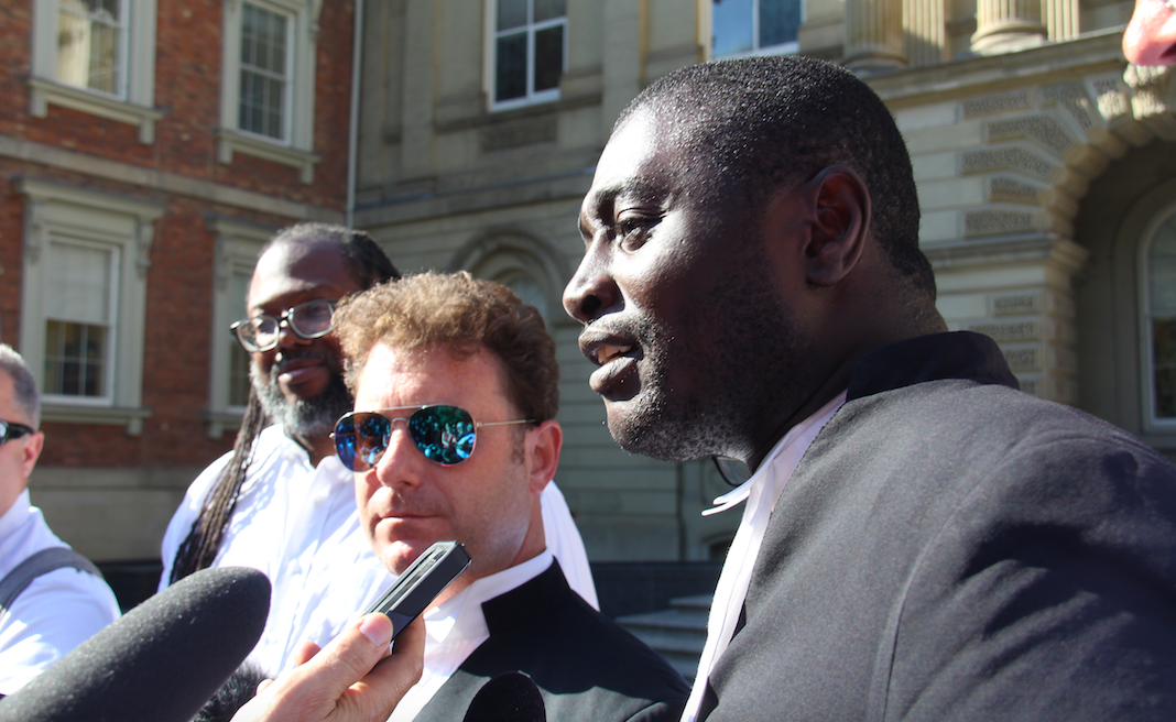 City council candidate Rocco Achampong, right, and his legal counsel Gavin Magrath, centre, speak to media following Court of Appeal hearings in Toronto on Tuesday, Sept. 18, 2018. Photo by Steph Wechsler