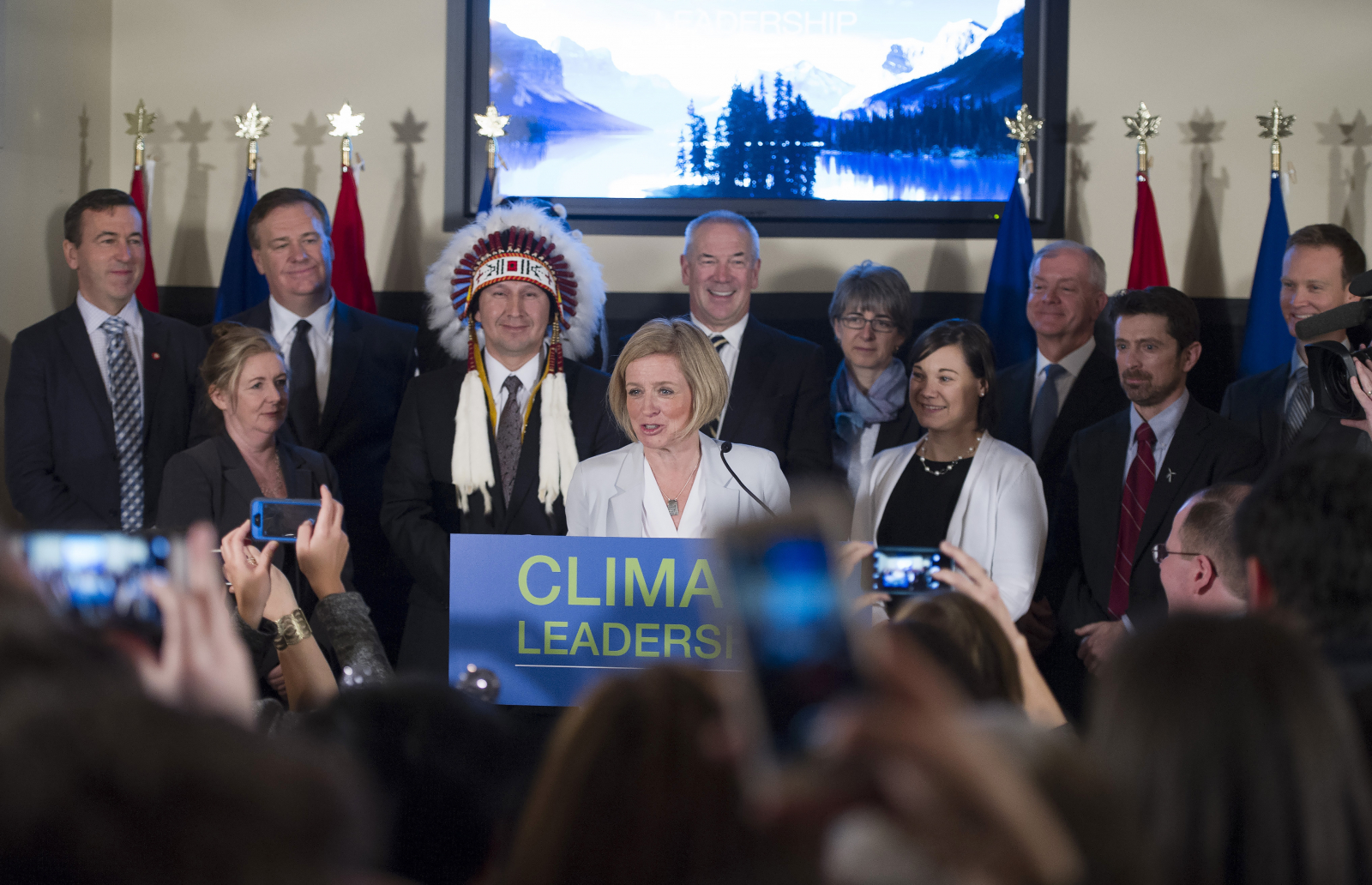 Alberta Premier Rachel Notley was flanked by Environment Minister Shannon Phillips (right) and oilsands industry leaders when she announced the province's climate leadership plan on Nov. 22, 2015 in Edmonton. Photo from the Government of Alberta