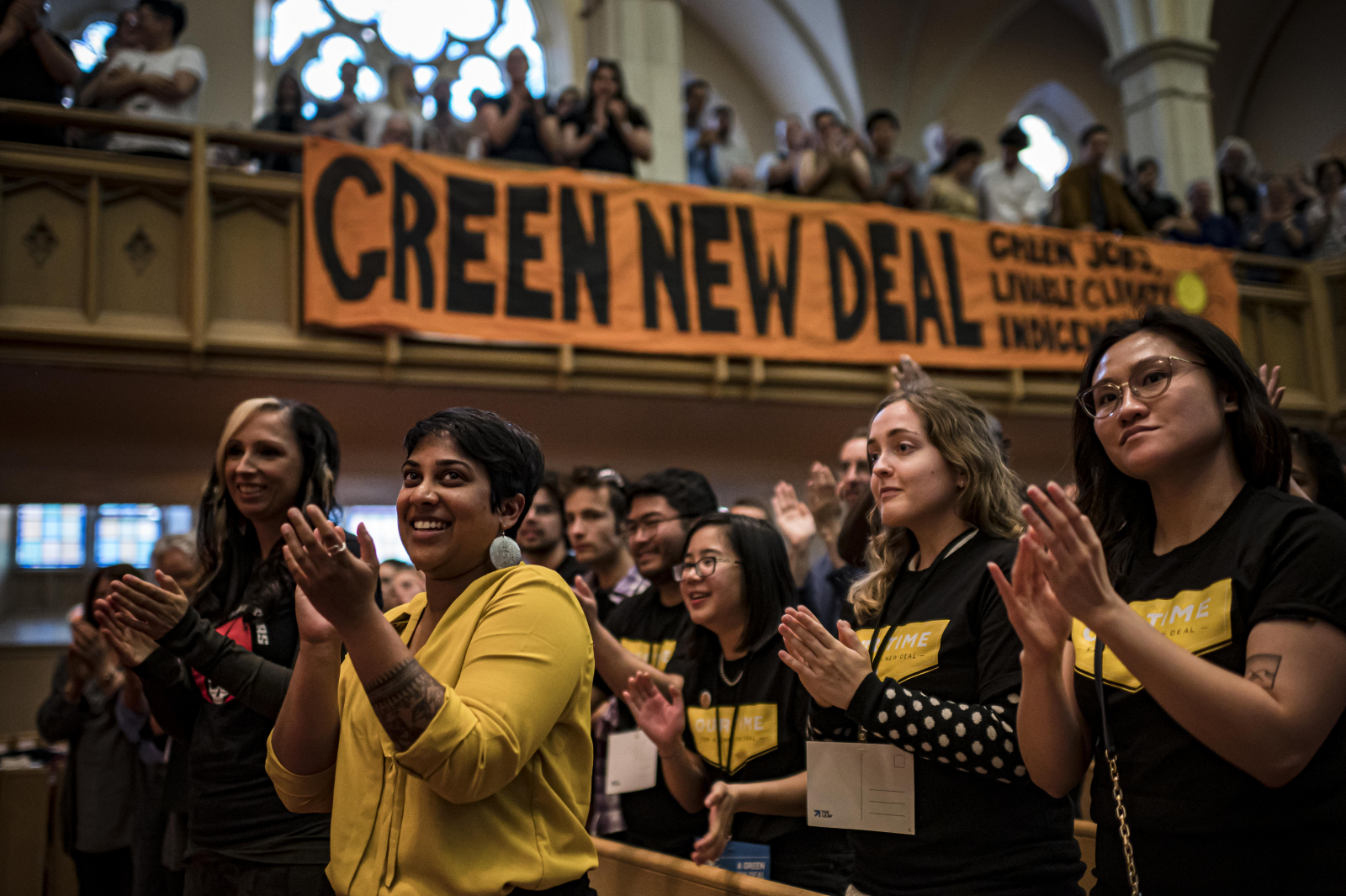 Pam Palmater, Maria Menezes, and supporters of the Our Time organization listen during the Green New Deal town hall at Bloor Street United Church in Toronto on June 11, 2019.
