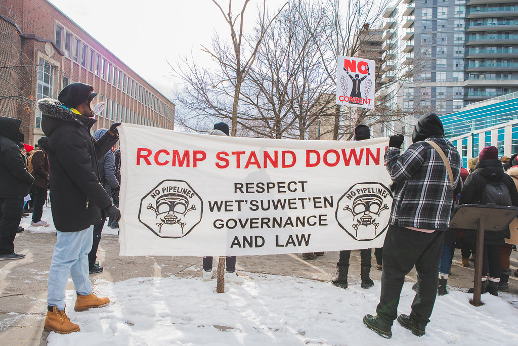 Land defenders hold banner 'RCMP Stand Down' and 'Respect Wet'suwet'en Governance and Law' - Wet'suwet'en Solidarity Event - Rail Yard near Pioneer Village Station Blockaded - Vaughan, Toronto, Ontario - February 15, 2020