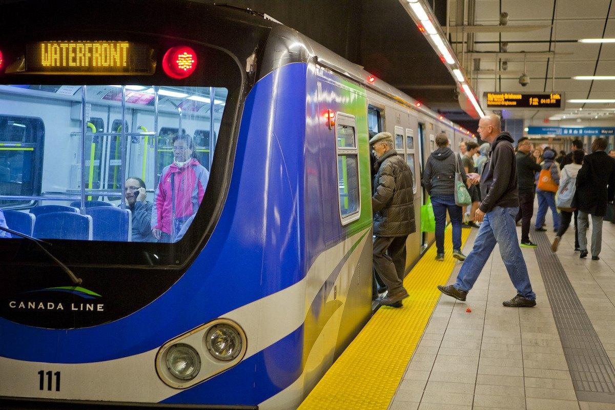 People board a public transit train