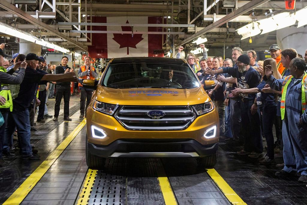 Joe Hinrichs drives the first car to the end of the production line, as Ford Motor Company celebrates the global production start of the 2015 Ford Edge at ...