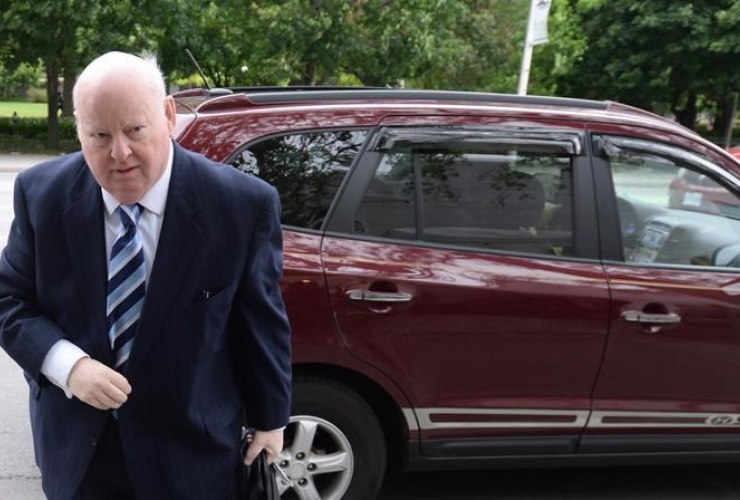 Suspended Senator Mike Duffy outside trial in Ottawa - CP photo