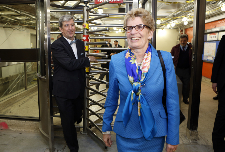 Cliamte Change Minister Glen Murray and Ontario Premier Kathleen Wynne exiting Toronto subway station - Ontario gov't photo