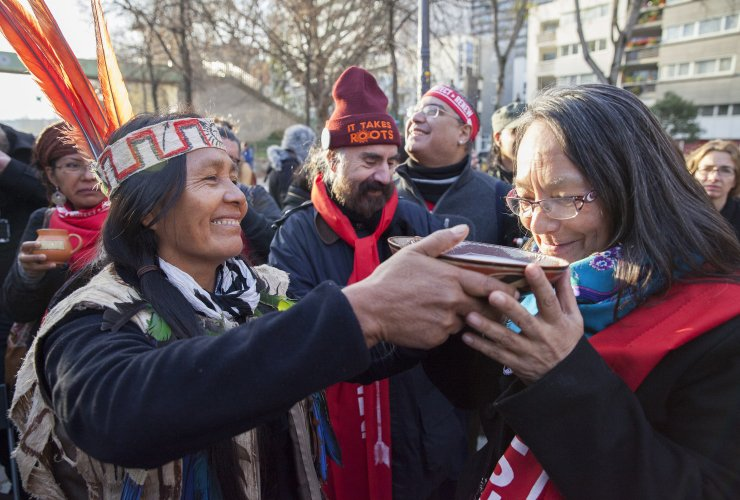 actress_tantoo_cardinal_gets_drink_from_ecuador_woman_paris_indigenous_rally_climate_talks_cop21_-_mychaylo_prystupa