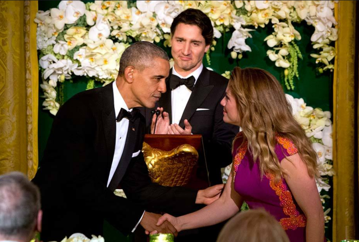 Barack Obama greets Sophie Gregoire-Trudeau while Justin Trudeau looks on.  Photo from Associated Press