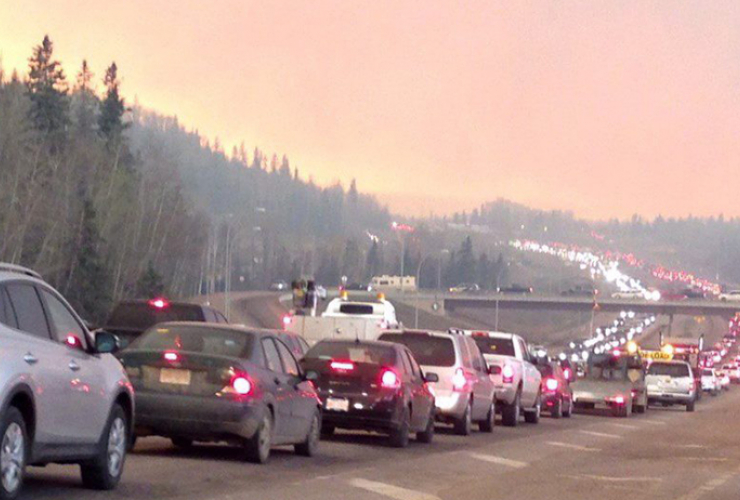 Cars stream out of Fort McMurray, fleeing the wild fire. Photo from Canadian Press