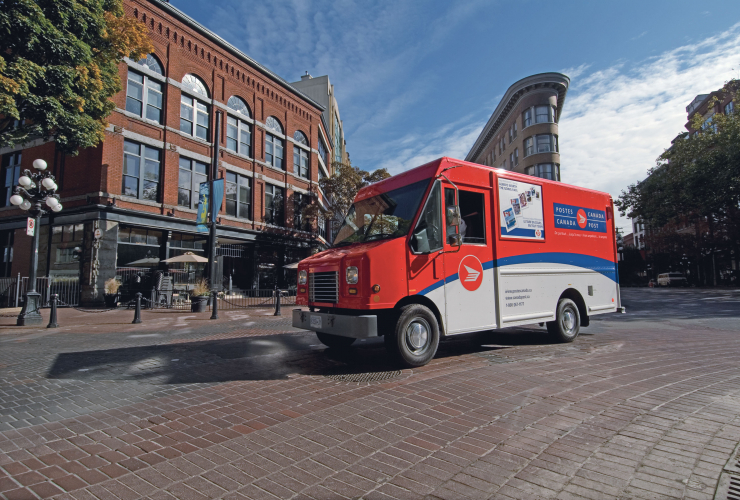 A Canada Post truck makes deliveries in Vancouver. Photo by Canada Post