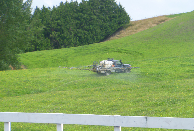 Spray truck in middle of New Zealand field. Envirowatchrangitikei