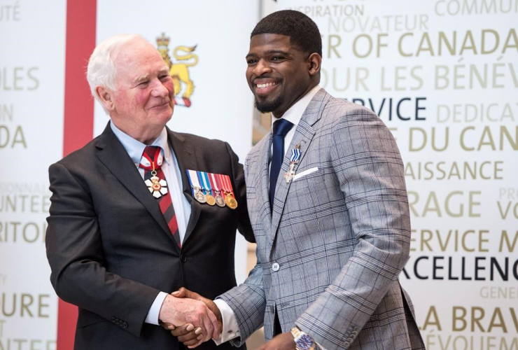 Nashville Predators' P.K. Subban shakes hands with Governor General David Johnston after receiving the Meritorious Service Decoration, Wednesday, March 1, 2017 in Montreal