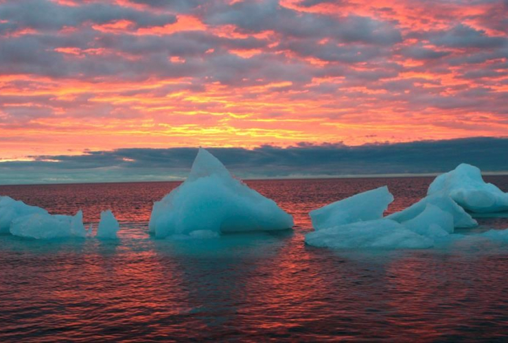 Ice chunks float in the Arctic Ocean as the sun sets near Barrow, Alaska on Sept. 13, 2006.