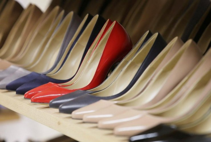 High heels on display in the Pretty Small Shoes store in Bloomsbury, London on March 6, 2017. Servers clad in short skirts and stilettos could soon be a thing of the past, as British Columbia and Ontario take steps to ditch sexualized dress codes.