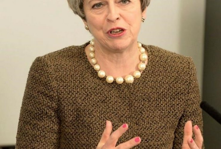 Britain's Prime Minister Theresa May speaks during a meeting with First Minister of Wales Carwyn Jones at the Liberty Stadium in Swansea, Wales, Monday March 20, 2017