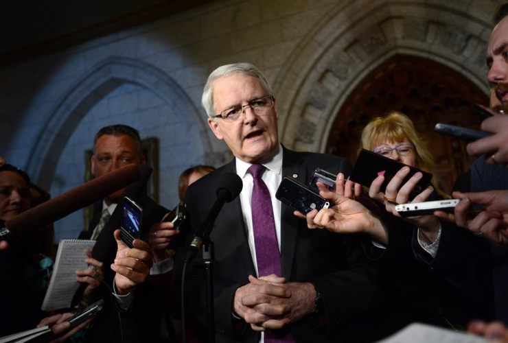 Transport Minister Marc Garneau speaks to reporters in the foyer of the House of Commons on Parliament Hill in Ottawa on Tuesday, March 21, 2017.