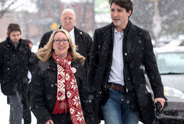 Prime Minister Justin Trudeau walks with Liberal candidate for Ottawa-Vanier Mona Fortier as they meet with constituents in the riding ahead of a by-election, in Ottawa on Friday, March 24, 2017.