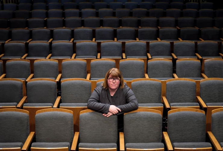 Vicki Stroich, Alberta Theatrre Projects executive director, sits in an empty theatre in Calgary, Alta., Thursday, March 16, 2017.