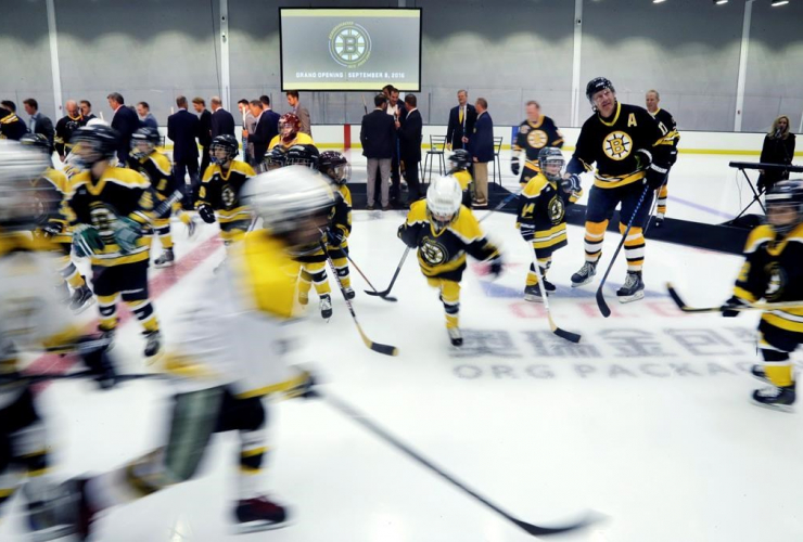 Youth hockey players take the ice after the ceremonial opening of Warrior Ice Arena, the new practice facility for the Boston Bruins NHL hockey team, Thursday, Sept. 8, 2016, in Boston.