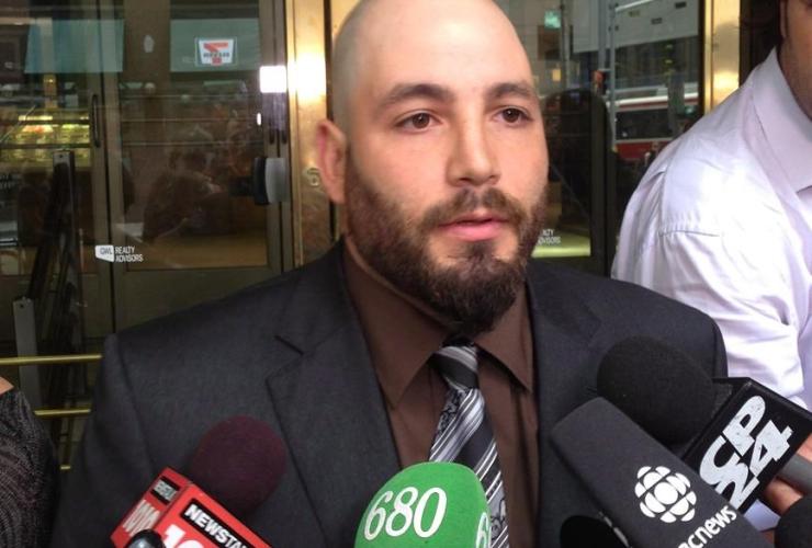Adam Nobody talks to media outside court in Toronto, Thursday, Sept.12, 2013.