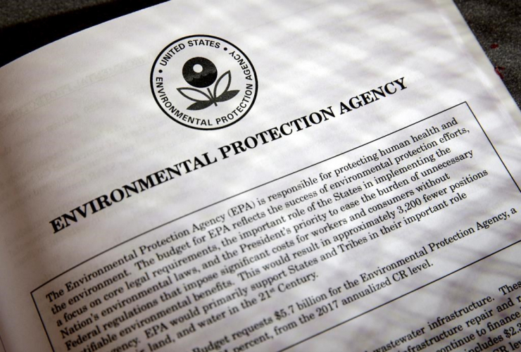 In this March 16, 2017, file photo, proposals for the Environmental Protection Agency (EPA) in President Donald Trump's first budget are displayed at the Government Printing Office in Washington.