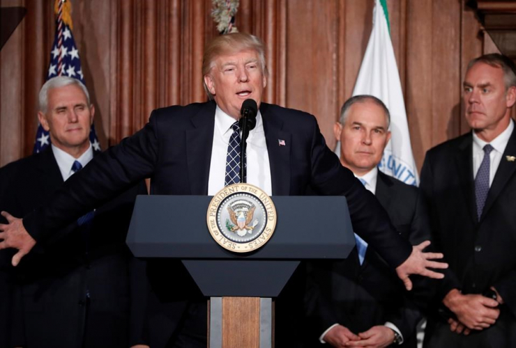 President Donald Trump, accompanied by from left, Mike Pence, Scott Pruitt, and  Ryan Zinke, speaks at EPA headquarters in Washington, prior to signing an Energy Independence Executive Order