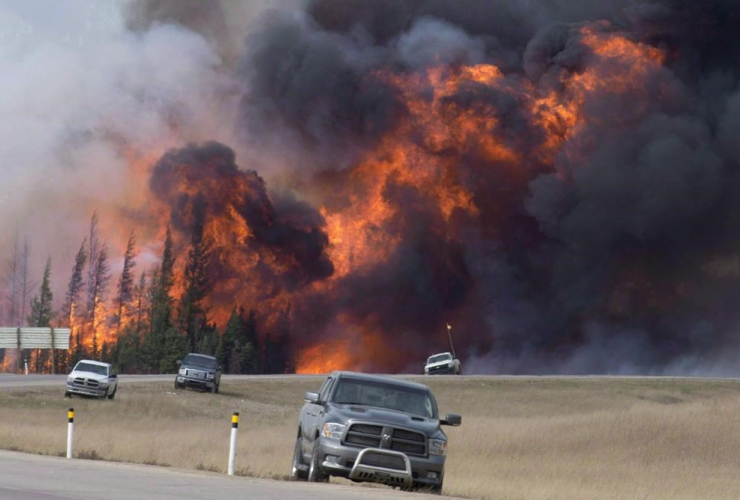 A giant fireball is seen as a wild fire rips through the forest 16 km south of Fort McMurray, Alta., on highway 63 on May 7, 2016.