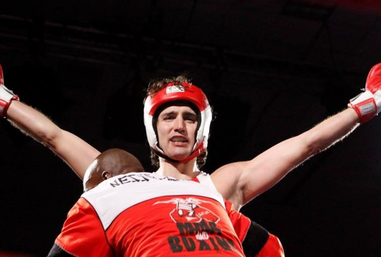 Justin Trudeau celebrates after defeating Conservative Senator Patrick Brazeau in a charity boxing match for cancer research, Saturday, March 31, 2012 in Ottawa.