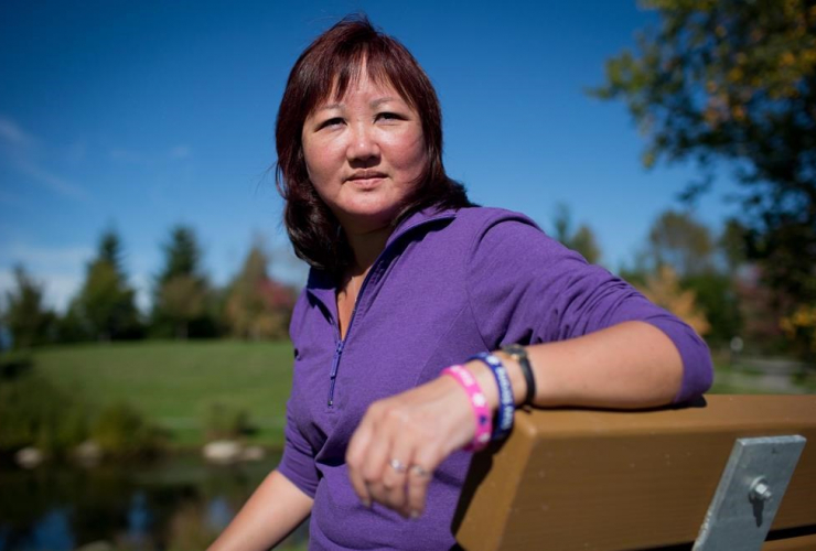 Carol Todd sits on a bench dedicated to her late daughter Amanda Todd at Settlers Park in Port Coquitlam, B.C., on Sunday October 5, 2013.