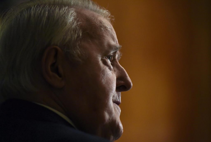 Former prime minister Brian Mulroney looks on during a media availability, before receiving the insignia of Commander of the National Order of the Legion of Honour from the Embassy of France, on Tuesday, Dec. 6, 2016 in Ottawa.