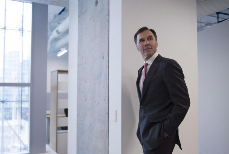 Morneau is seen during a tour of the Vector Institute at the MaRS Discovery District, in Toronto in a March 30, 2017