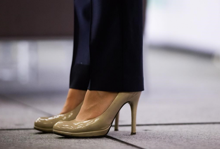 British Columbia Premier Christy Clark wears high heels while addressing the Council of Forest Industries convention in Vancouver, B.C., on Friday April 7, 2017.