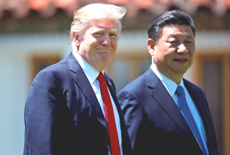 President Trump and Chinese President Xi Jinping walk together after their meetings at Mar-a-Lago, Friday, April 7, 2017, in Palm Beach, Florida.