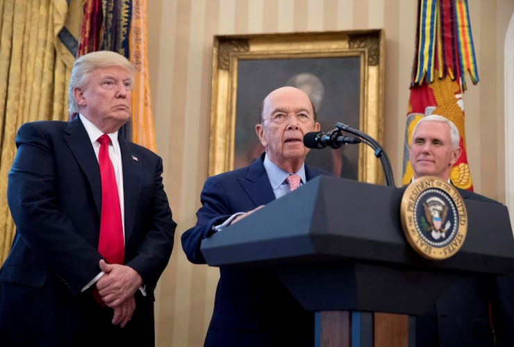 Wilbur Ross, center, accompanied by President Donald Trump, left, and Vice President Mike Pence, right, speaks during a signing ceremony for executive orders regarding trade in the Oval Office at the White House, Friday, March 31, 2017, in Washington.