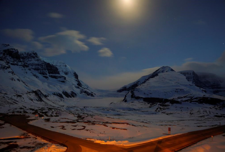 The Athabasca Glacier, centre, part of the Columbia Icefields in Jasper National Park, Alta., is seen in moonlight during a long exposure Wednesday, May 7, 2014.