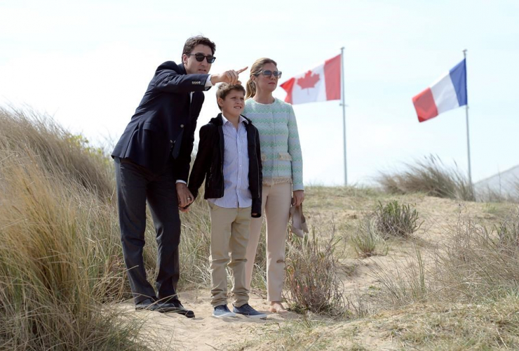 Prime Minister Justin Trudeau, left, Sophie Gregoire-Trudeau, right, and their son Xavier visit Juno Beach in Courseulles-sur-Mer, France, on Monday, April 10, 2017.